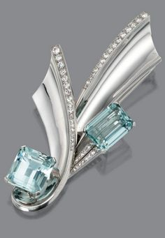 WHITE GOLD, AQUAMARINE AND DIAMOND  BROOCH, CIRCA 1945   the brooch of stylized ribbon design set with 2 emerald-cut aquamarines, further decorated with numerous small round and single-cut diamonds, the total diamond weight approximately 3.20 carats, mounted in 14 karat white gold.