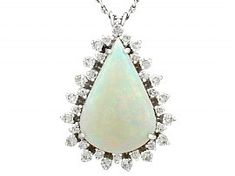 An impressive vintage 8.02 carat white opal and 1.36 carat diamond, 18 carat white gold pendant with 14 carat white gold chain; part of our diverse gemstone jewellery collections