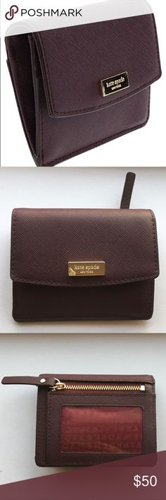 Kate Spade Laurel Way mulledwine wallet card case Wallet is brand new with tags and will ship with store bag. Offers welcomed!  Features: Gold toned hardware Saffiano leather  Front has snap closure 6 credit card slots, 1 clear ID slot in back, and zip coin pocket kate spade Bags
