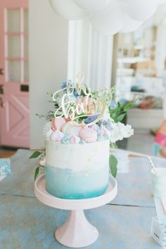 Project Nursery - Oh Baby cake topper on ombre blue cake with pink macarons and meringues - Project Nursery