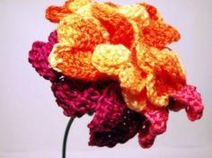 This site is the motherlode of free crochet flower patterns!  http://melibondre.com/blog/?p=306