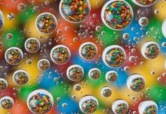 Photographer Patrick Lindsay shot this beautiful photograph of gumballs seen through water drops. It's similar to the MC Escher water drop photo we shared