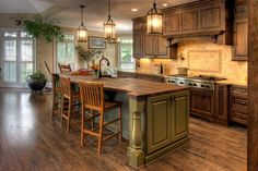 Open kitchen with gorgeous cabinets and a beautiful green island