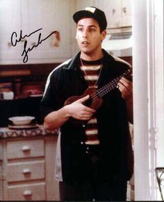 Adam Sandler:):) all i want is a signed adam sandler picture...is that too much to ask for?!