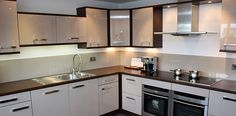 Wide plank black walnut worktops with inset hob and stainless steel sink. Matching black walnut end panels and flying shelf. Stainless Steel Sinks, Wide Plank, Work Tops, Kitchen Cabinets, Walnut Worktops, Shelves, Kitchen Ideas, Home Decor, Black