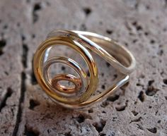 Silver ring with colorful circles in bronze and brass