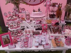 Incredible horse themed pink girl birthday party dessert table! See more party planning ideas at CatchMyParty.com!
