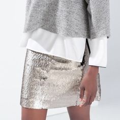 "NWT Zara Sequin Miniskirt NWT Zara Sequin Miniskirt. When the holidays arrive you'll be ready to go!  Or for a little Vegas trip...  OR, wear sequins year 'round like I do! Lol!  Black lining and black waistband. Exposed side zipper. Sequins are closer to a pewter than shiny silver, giving the skirt a chic, sophisticated elegance. Waistband measures 13"" laying flat. Skirt is 14"" long.  Looks amazing with a little black cashmere sweater and heels! Host Pick x 8 Zara Skirts Mini"