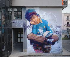 Italy Street Art by El niño de las pinturas in Battipaglia, Italy by Benedetto Battipede.