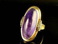 Antique cabochon amethyst ring