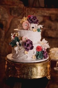 """Bright wedding cake idea - three-tiered wedding cake idea with bright color sugar flowers and """"to the moon and back"""" cake topper   {James Tang Photography}"""