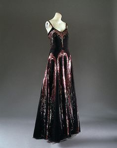 Date: fall/winter 1938–39 Culture: French Medium: silk, plastic, suede, glassThe decoration of sequined fireworks on this evening dress, which was worn by Countess Madeleine de Montgomery to Lady Mendl's seventy-fifth birthday party in 1939, is a fitting climax to le beau monde of the 1930s. When Adolf Hitler declared that Germany was at war with Poland in September 1939, the glamorous era of the 1930s came to a close.