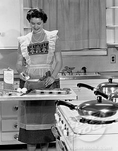Vintage happy housewife and her muffins.