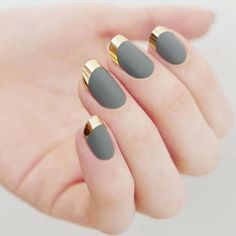 Soft grey matte polish and a gold chrome color are all you need for this sophisticated nail design.
