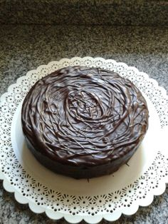 Chocolate cake, filled with dulce de leche and whipped cream. Covered with dark chocolate ganache.
