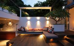 Small Outdoor Space, love the lighting, planter and living space