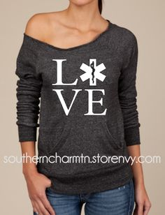 A raw-edge, off-the-shoulder neckline and kangaroo front pocket give this cozy sweatshirt its vintage-inspired appeal. Made with natural fleece alternative, its the perfect way to stay warm in style. This is meant to be a looser, relaxed fit so I always r Paramedic Student, Firefighter Paramedic, Littmann Stethoscopes, Emergency Medical Services, Slouchy Sweater, Firefighting, Raw Edge, Stay Warm, Cant Wait