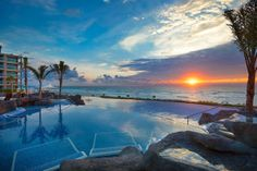 hard-rock-hotel-cancun-pool-sunrise - Call About Going Places Travel Agency today to book your stay! 404-256-1131/ travel@aboutgoingplaces.com