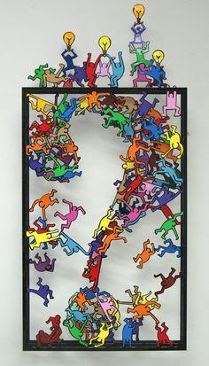 Sculpture de David Kracov (personnages semblables à Keith Haring)