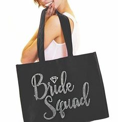 "Our giant 18"" x 14"" tote is perfect for the Bride Squad! Made of 100% organic cotton canvas, this tote bag says BRIDE SQUAD in real multi-faceted crystal rhinestones accented with a silver foil diamond. Because its made with high quality materials, its perfect for Wedding planning, spa trips or parties! Plus, our totes are made when you order (in just 1 days!) by a rhinestone artist right here in the USA! Team Bride, Silver Rhinestone, Large Canvas, Faceted Crystal, Large Tote, Canvas Tote Bags, Cotton Canvas, Rhinestones, Squad"