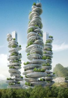 Sustainable 'farmscrapers' for Shenzen unveiled by Vincent Callebaut Architects  A masterplan featuring six sustainable 'farmscrapers' formed of pebble-like structures has been unveiled by French firm Vincent Callebaut Architects. Located in Shenzen, China, the Asian Cairns project showcases a distinctive urban system with each 'farmscraper' consisting of three interlacing eco-spirals of pebbles which weave their way up two megalithic towers. The project has been designed in response to the…