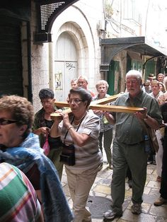 Christian pilgrims carrying the cross on the Via Dolorosa, Old City, Jerusalem