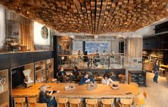 Amsterdam Starbucks - Interior - All the furniture such as benches, tables and the feature ceiling are all re-purposed in Dutch oak.