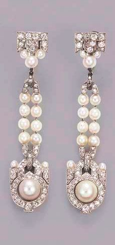 AN ATTRACTIVE PAIR OF BELLE EPOQUE PEARL AND DIAMOND EARCLIPS, BY CARTIER Each designed as an openwork old-cut diamond geometric panel with pearl centre suspended from the pearl twin line and pavé-set diamond surmount, circa 1910, 5.9 cm. long One signed Cartier