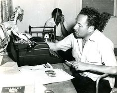 Tennessee Williams, January 1957, Key West home office. Partner Frank Merlo in background.