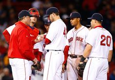 John Lackey #41 of the Boston Red Sox is pulled from the game in the 7th inning by manager John Farrell #53 against the Atlanta Braves on May 28.