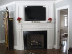 corner fireplace designs with tv above - Would use this setup minus the fireplace and put a window seat by the windows. Corner fireplace with warm cherry wood mantel. Fireplace Molding, Tv Over Fireplace, Build A Fireplace, Faux Fireplace, Fireplace Design, Fireplace Mantels, Fireplace Ideas, Mantles, Mantle Ideas