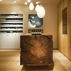 "In Praise of Shadows uses dead wood from a Stockholm park in first Swedish Aesop store. In Praise of Shadows combined warm beige plasterwork with a range of wood finishes to create a ""rich tactile experience"" for Aesop Bibliotekstan. Shop Interior Design, Retail Design, Store Design, Interior Styling, Aesop Shop, In Praise Of Shadows, Retail Interior, Retail Space, Wood"