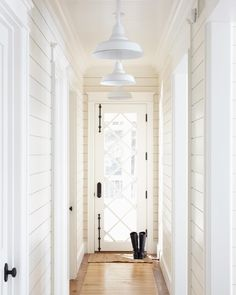 All white and the door, the v-groove walls, make a skinny entry so pleasant. ingt+muskoka+interiors+.jpg 766×960 pixels
