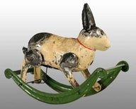 hand-painted tin rabbit on rocker wind-up toy c. 1885-1925, Germany