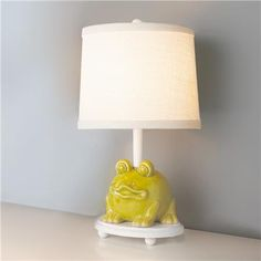 Lime green frog piggy bank table lamp.