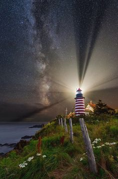 Night Over West Quoddy is a photograph by Michael Blanchette. Located in Lubec, Maine. It sits on the easternmost point of the contiguous United States. The first lighthouse tower was erected here in 1808, with the current lighthouse constructed in 1858. it is one of Maine's most recognized lighthouses, painted in alternating red and white stripes. It was added to the National Register of Historic Places in 1980, and featured on a 25 cent US stamp in 1990. Source fineartamerica.com