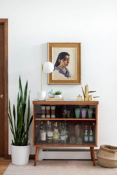 Thrift Store Score: A Retro Bar Cabinet & Portrait | DreamGreenDIY | Bloglovin'