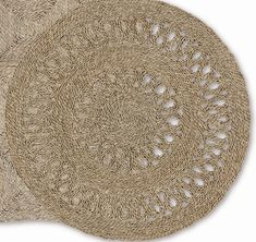 Crafted from woven seagrass, this handmade door mat adds a natural touch to your home.