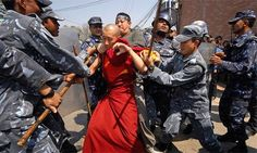 A buddhist monk being restrained and beaten.