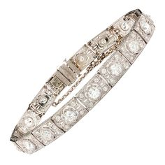 Art Deco J.E. Caldwell Diamond Bracelet. Art Deco J.E. Caldwell Platinum Bracelet Features 17 Old European Cut Diamonds of 4.50cts on Beautifully Crafted Links with Milgrain and Filigree Details. The main stones are enhanced by another 68 diamonds weighing 1.40cts. The bracelet is 8.25 inches long and measures 8mm wide. The total weight is 26.5 grams.