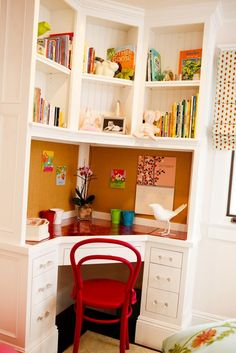 Built-in corner desk - good space saver for a small room, could be feminine or masculine easily.