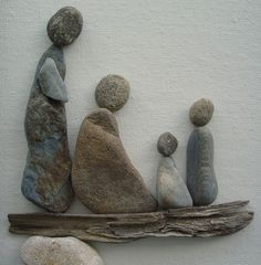 Pebble Art: Pebbles  driftwood on canvas.