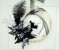 Black and Silver Christmas Wreath with Feathers. $129.00, via Etsy.