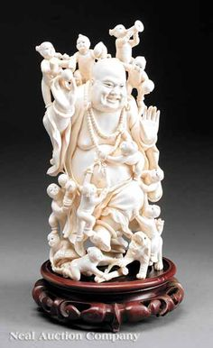 Chinese Carved Ivory Figural Group of Budai,