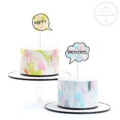 A watercolour cake duo for a his and hers birthday celebration