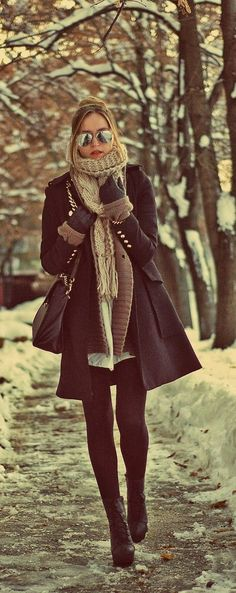 light brown heavy scarf, black long coat, black leggings, black ankle boots