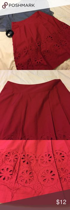 Gorgeous red skirt with circle detail and pockets! Beautiful shade of red! The detail on this skirt reminds me of cut oranges. Zipper on side and has pockets! Very classy! LOFT Skirts