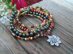 Bohemian Gypsy Stretch Beaded Bracelets with Flower Charm - Green Swarovski Pearl and Wood Bracelet Set. $26.50, via Etsy.