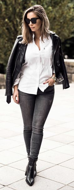 Emilie Tømmerberg + leather jacket style + absolute classic + white shirt + black jeans + biker jacket + ultimate androgynous chic look + Chelsea boots + great everyday style. Outfit: Zara.