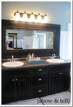 Framing bathroom mirrors, I thought about getting rid of my huge mirror and replacing it with two framed ones, but this may be the cheaper way to go and stylish too!